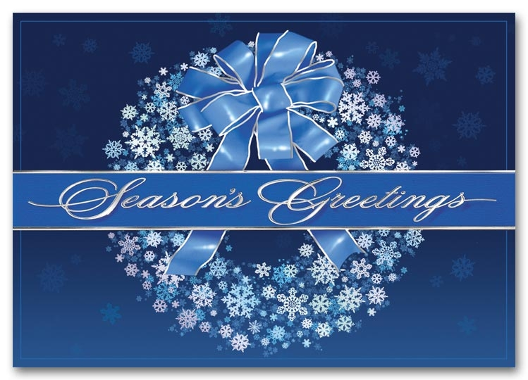 Holiday cards with a silver wreath on a blue background.